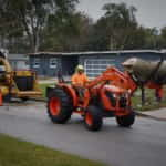 Our Kubota Tractor Makes Easy Work of Moving Larger Sections of Branches and Trunks